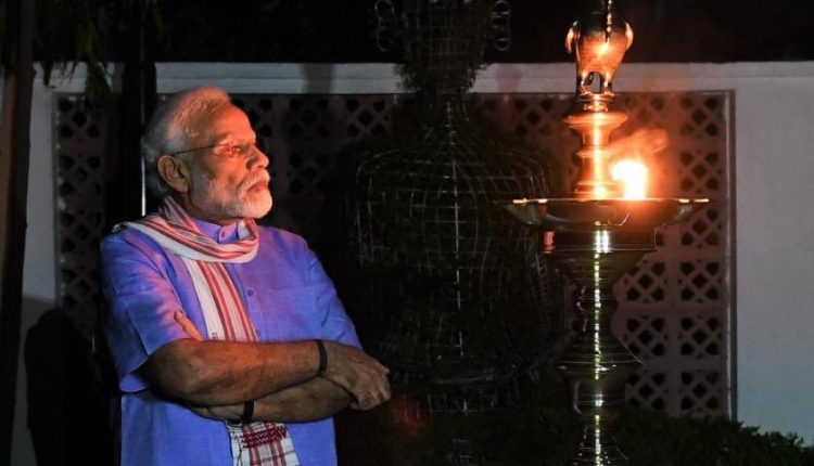 PM Modi lighting a lamp on the occasion of 9 minutes at 9 pm on 5th April, 2020